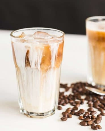 Delicious drink concept - Iced coffee in a glass with ice